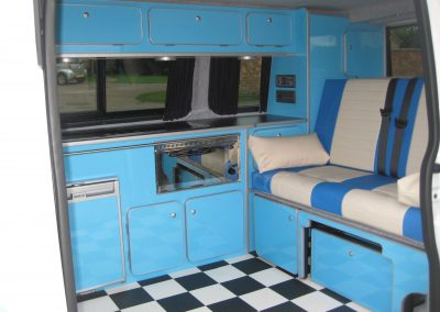 rock and roll bed with knee roll, blue and cream vinyl (1) camper gallery CAMPER GALLERY rock and roll bed with knee roll blue and cream vinyl 1 400x284